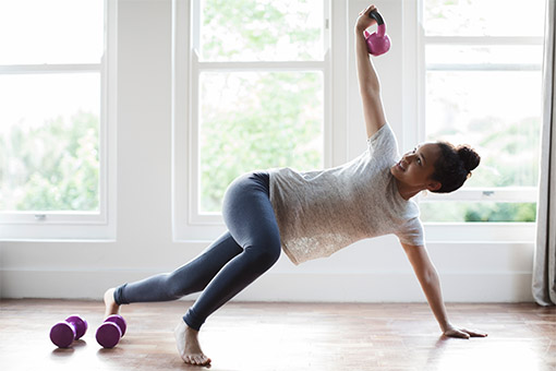 Women working out with a kettlebell after taking CBD
